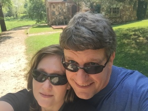I was joined by my significant other, who graciously indulged my Laura time and listened to me talk about the books for hours on end. We're standing in front of the Rock House that Rose built. She ordered the plans from a Sears catalogue.